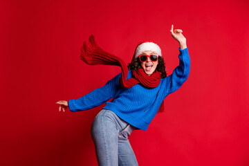 Portrait of her she nice attractive slim fit overjoyed carefree cool cheerful girl wearing casual festal outfit dancing having fun rest chill isolated bright vivid shine vibrant red color background