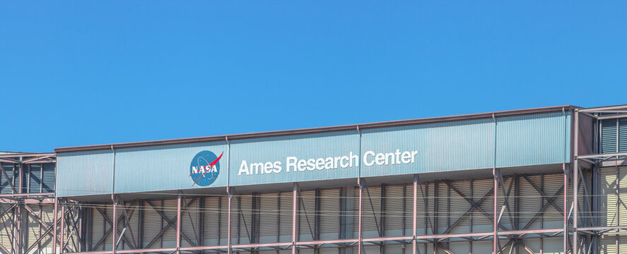 Mountain View, United States - August 15, 2016: NASA National Aeronautics and Space Administration building and signboard, 230 jones road at Moffett Federal Airfield.