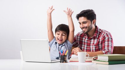 Online school in India concept - Cute little son taking father's help in studies or homework