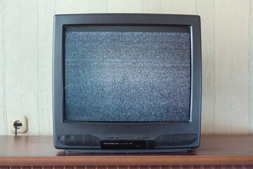 glith television analog signal on tv screen on wooden stand closeup