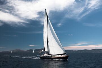 Wall Mural - Luxury sailing. Sailboat in the regatta in the Aegean Sea.