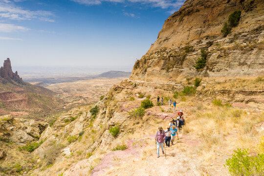 Ethiopian guides with tourists hiking to Gheralta Mountains, Tigray Region, Ethiopia