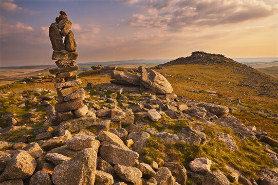 Granite boulders on the summit of Rough Tor, one of the highest points of Bodmin Moor, lit by evening sunlight, north Cornwall