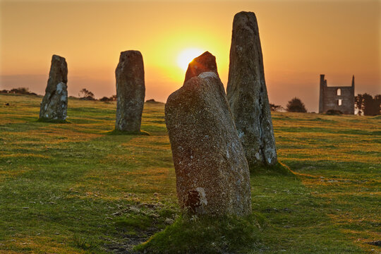Sunrise over standing stones at the Hurlers, a series of prehistoric stone circles on Bodmin Moor, near Liskeard, east Cornwall