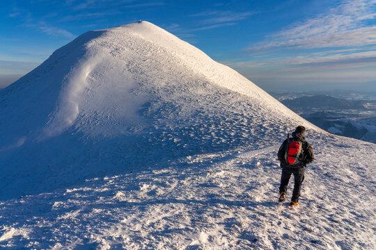 Hiker near the summit in winter, Mount Acuto, Apennines, Umbria