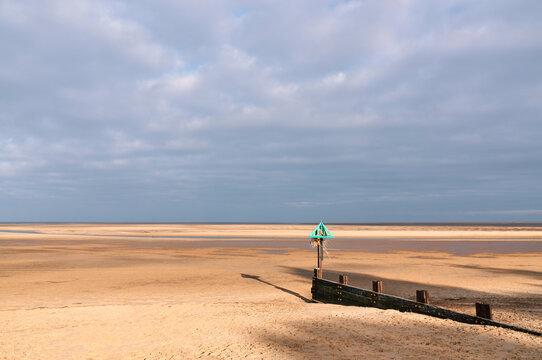 Groyne at low tide. Wells-next-the-sea, Norfolk, UK.
