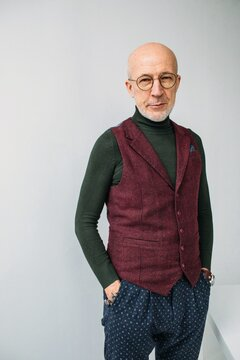 Trendy man posing by white background