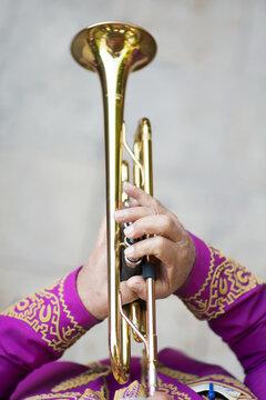Closeup of Mariachi band member playing trumpet