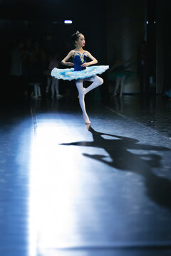 Asian girls perform ballet on stage