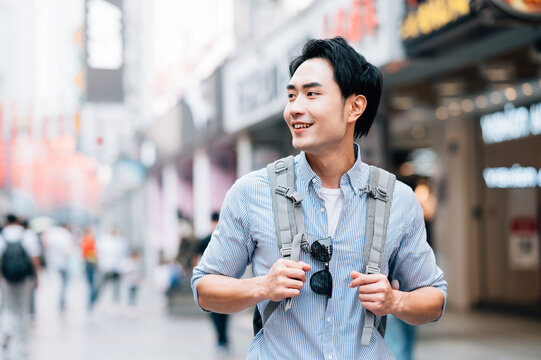 Young asian man traveling in a city downtown