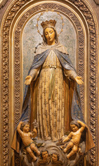 BARCELONA, SPAIN - MARCH 3, 2020: The carved polychrome statue of Immaculate Conception in the church Iglesia Santa Maria de Gracia de Jesus.