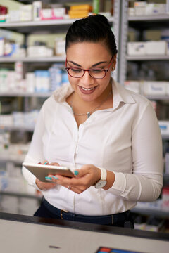 Pharmacist working on electronic tablet