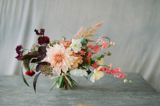 Flower bouquet against grey cloth background with copy space