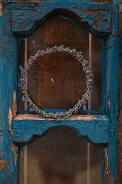 Old painted blue door decorated with an lavender wreath