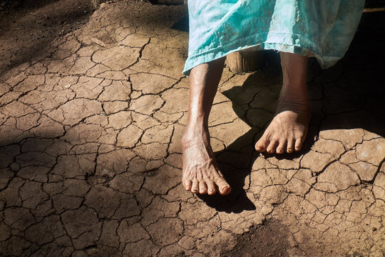 Photo of anonymous old woman during a drought