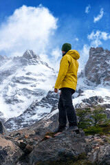 A hiker looks over Cerro Torre, Patagonia, Argentina