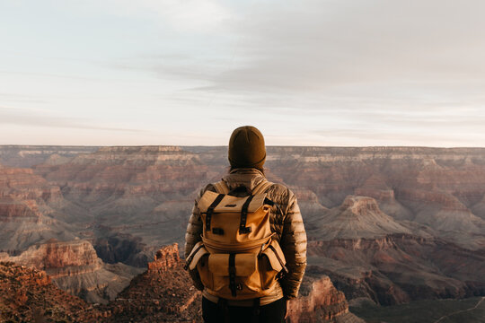 A woman looking out towards the Grand Canyon