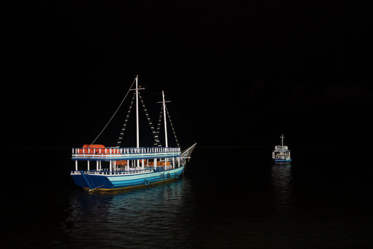 Two boats in the night
