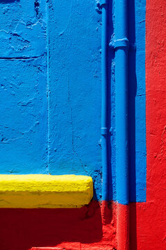 Detail of a yellow, blue and red wall in Caminito Street, Buenos Aires