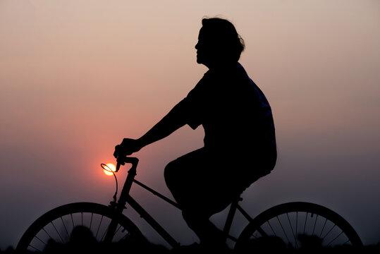 Grandmother riding bicycle