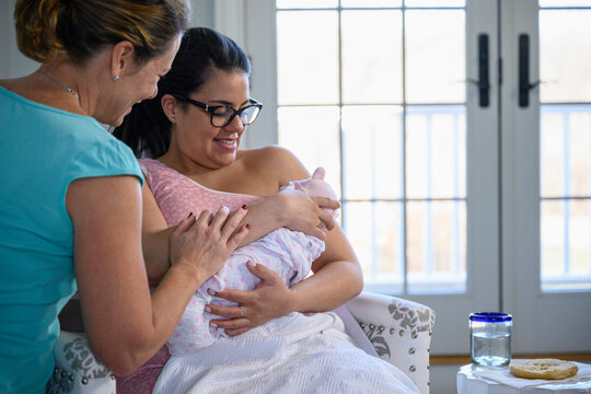 Doula Working with Expecting Beautiful Mother at Home