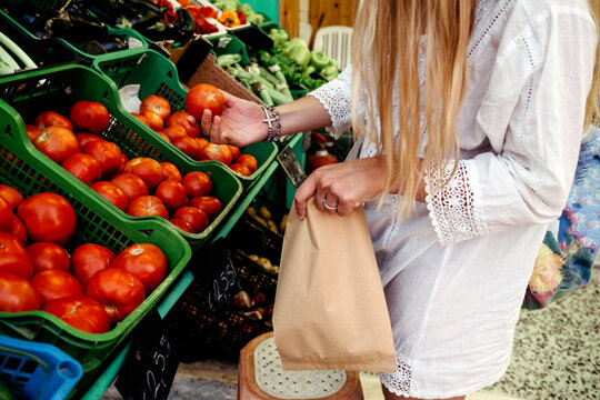 Female model buying groceries in the supermarket on vocation