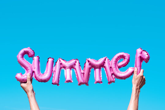 word summer in a pink balloon