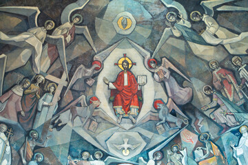 BARCELONA, SPAIN - MARCH 5, 2020: The modern fresco of Jesus among the saints in church Santuario Maria Auxiliadora i Sant Josep by Fidel Trias Pages and Raimon Roca (1966).
