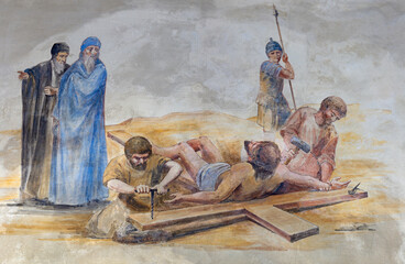 BARCELONA, SPAIN - MARCH 5, 2020: The fresco Jesus is nailed to the cross (part ot Via Crucis) in the atrium of church Església de la Concepció from 19. cent.
