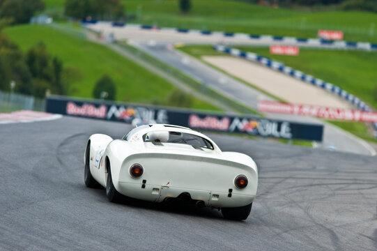 vintage porsche 910 racecar on a race track in austria