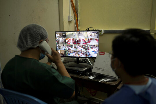 Medical staffs work inside a control room at a quarantine center amid the outbreak of the coronavirus disease in Yangon, Myanmar