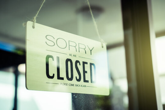 """Vintage retro wooden sign with words """"Sorry We Are Closed, Please Come Back Again"""""""