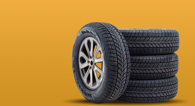 Car tires isolated on yellow background
