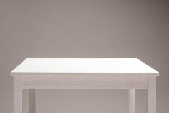 light wooden empty table surface, background beige dark