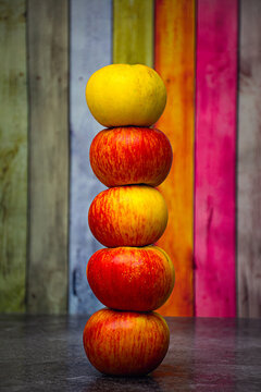 Apples stacked as a tower.