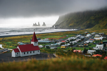 Wall Mural - Heavy clouds over the village of Vik i Myrdal in Iceland