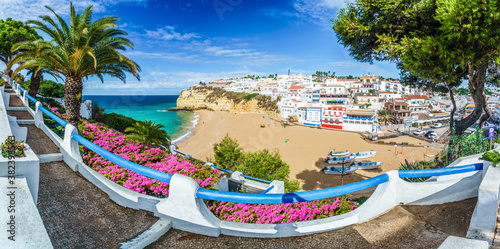 Wall mural Carvoeiro town with colorful houses and yellow sand beach in Algarve, Portugal