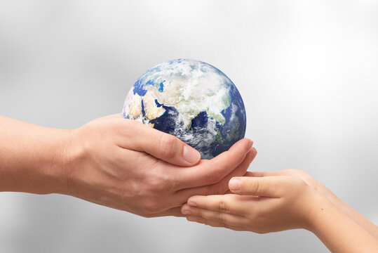 Earth globe in hands. World environment day. Elements of this image furnished by NASA