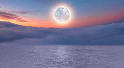 Wall Mural - Dusk sky with full moon in the clouds at subset, calm sea in the foreground