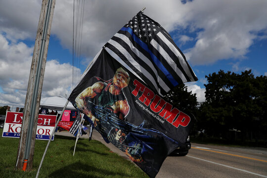 A Blue Lives Matter flag and a flag for U.S. President Donald Trump blow in the wind outside a merchandise tent in Cortland, Ohio