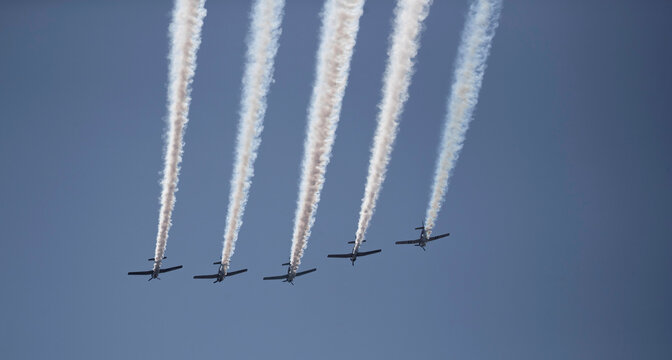Airplanes perform a flyover during the reopening ceremony for the Gerald Desmond Bridge in Long Beach