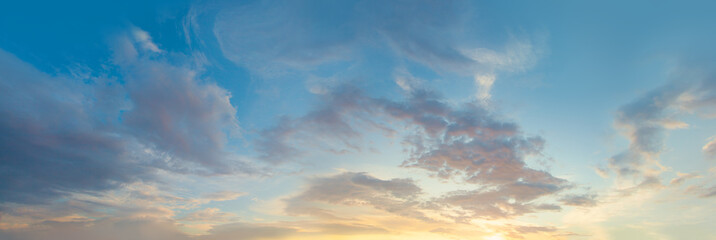 Sunset sky panorama. Blue sky with clouds and sun, beautiful landscape panorama skyline background