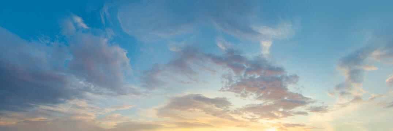 Sunset sky panorama. Blue sky with clouds and sun, beautiful landscape panorama skyline background