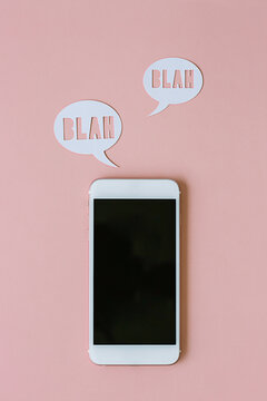Phone and icons on pink background
