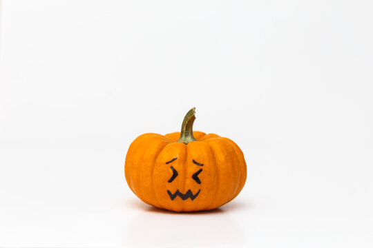 pumpkin with confounded emoticon face