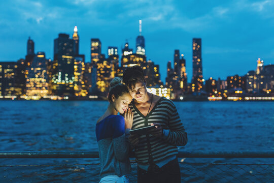 Young Couple Using a Digital Tablet Against the Manhattan NY Skyline