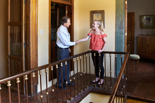 Real estate agent shaking hands with client