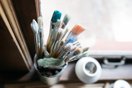 paint brushes tools for ceramic design on desk in home studio workshop
