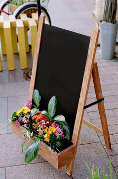 Chalkboard sign with flowers at the entrance