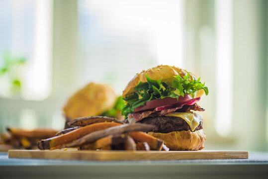 Home-made burger and sweet potato fries